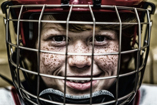 Boy With a Football Helmet Smiling