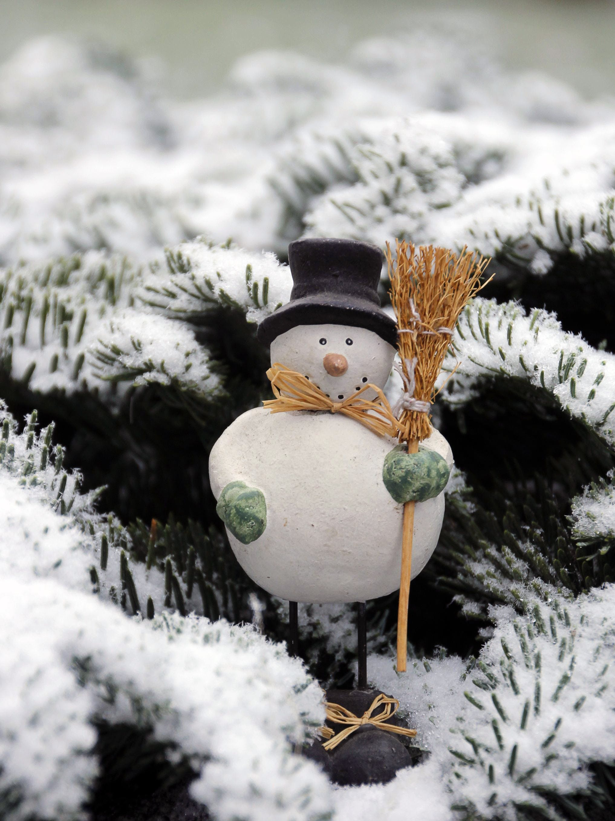 Snow Man Wearing Black Hat Holding Brown Broom