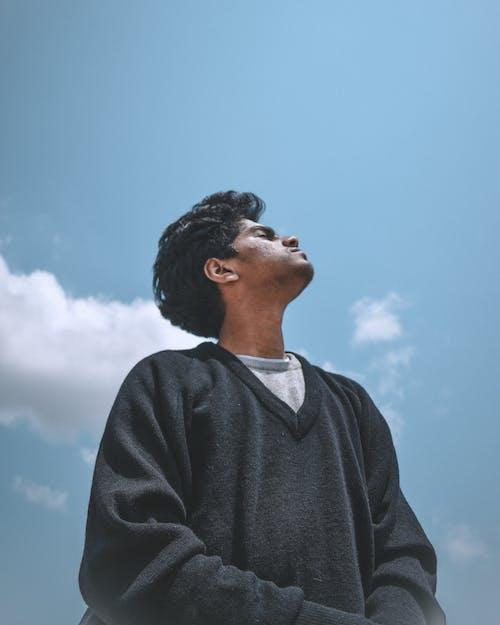 Man in Black Sweater Under Blue Sky