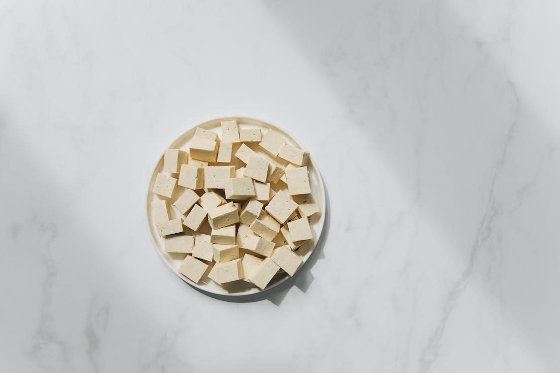 Photo of Tofu on White Plate Against White Background