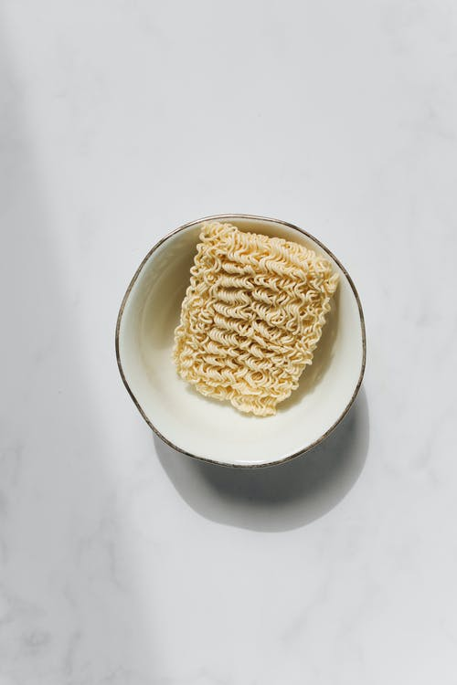 Photo of Uncooked Noodles on White Bowl