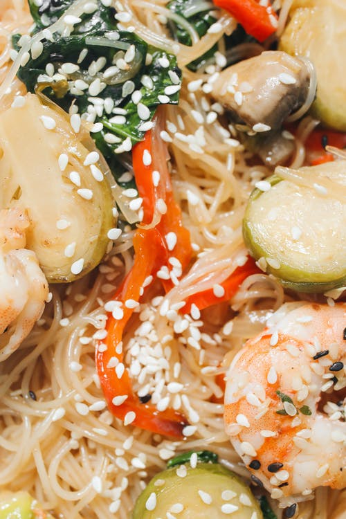 Close-Up Photo of Noodle Dish With Shrimp and Sesame Seeds