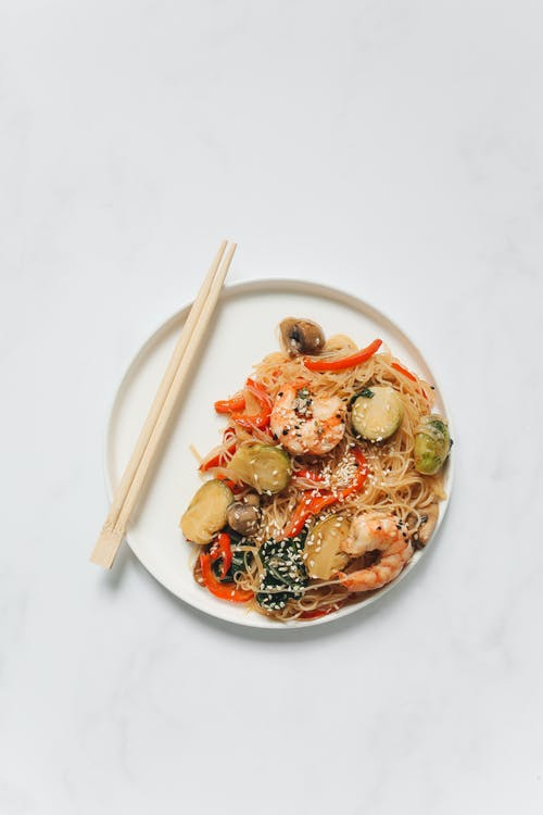 Noodle Dish With Shrimp on White Ceramic Plate