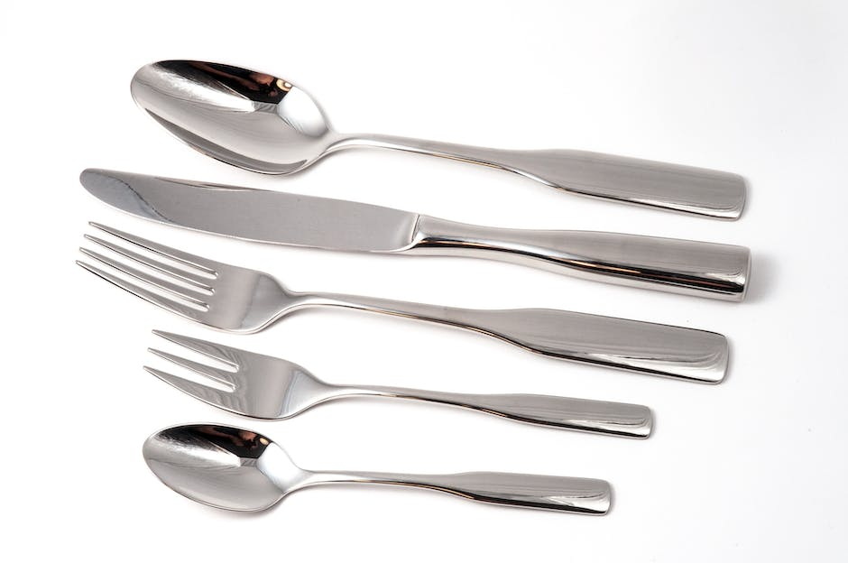Silver Spoon Near Silver Kitchen Knife