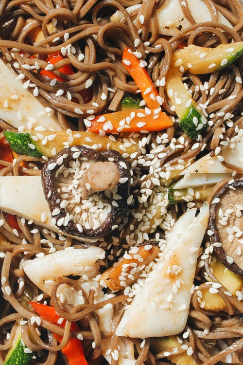 Close-Up Photo of Noodle Dish With Sesame Seeds