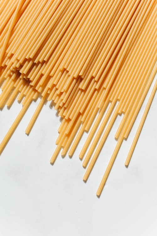 Uncooked Noodles on White Surface