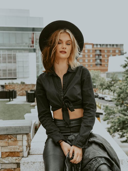 Flirting woman in black cool outfit