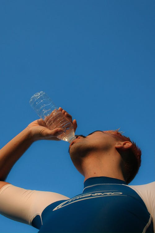Sportive man drinking from bottle