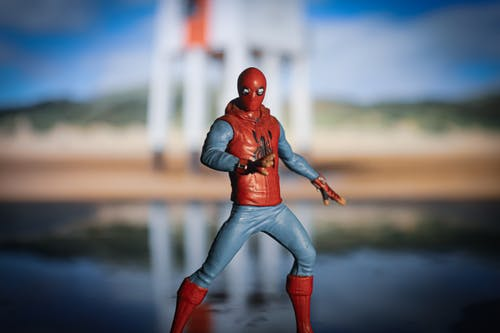 Free stock photo of boy, figurine, reflection, spider man