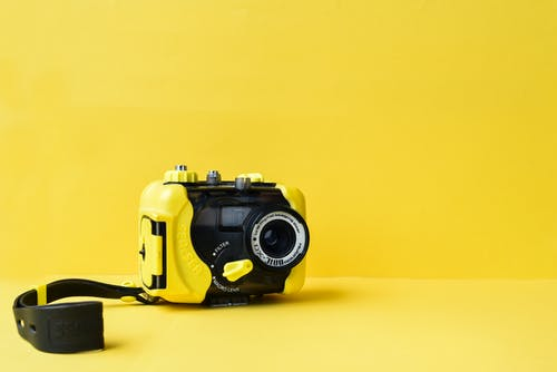 Waterproof Camera on Yellow Background