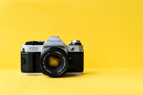 Film Camera on Yellow Background