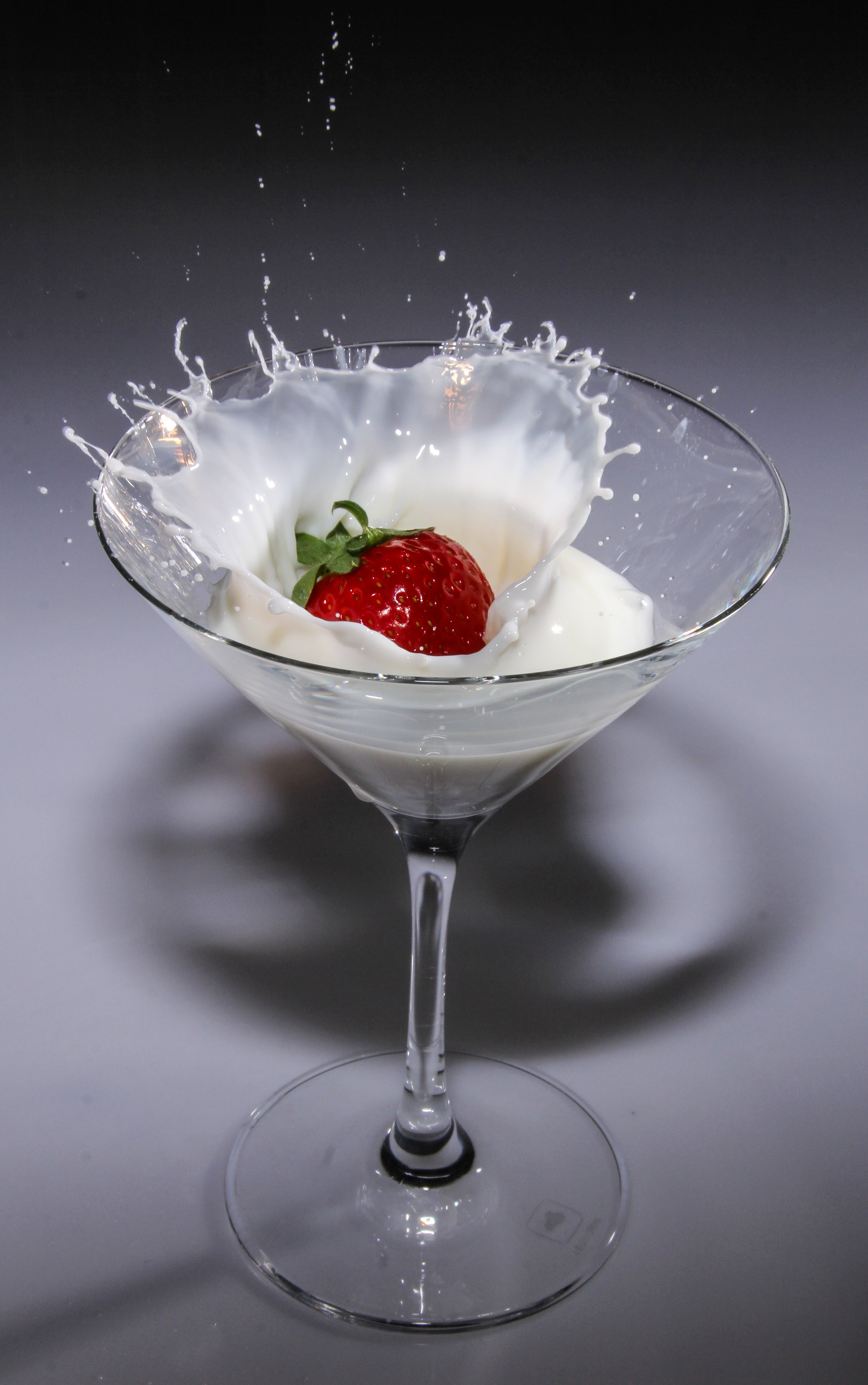 Clear Long Stem Wine Glass With Strawberry and White Liquid
