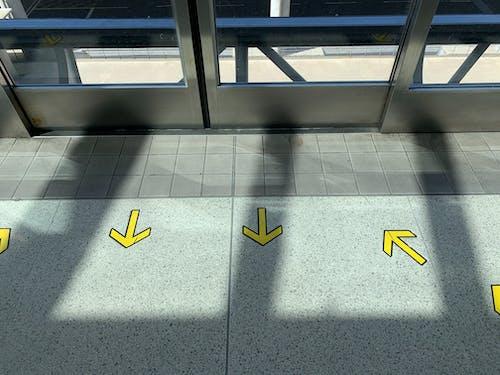 Yellow arrows on tiled floor in building