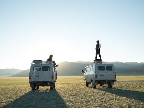 Couple of travelers in desert terrain