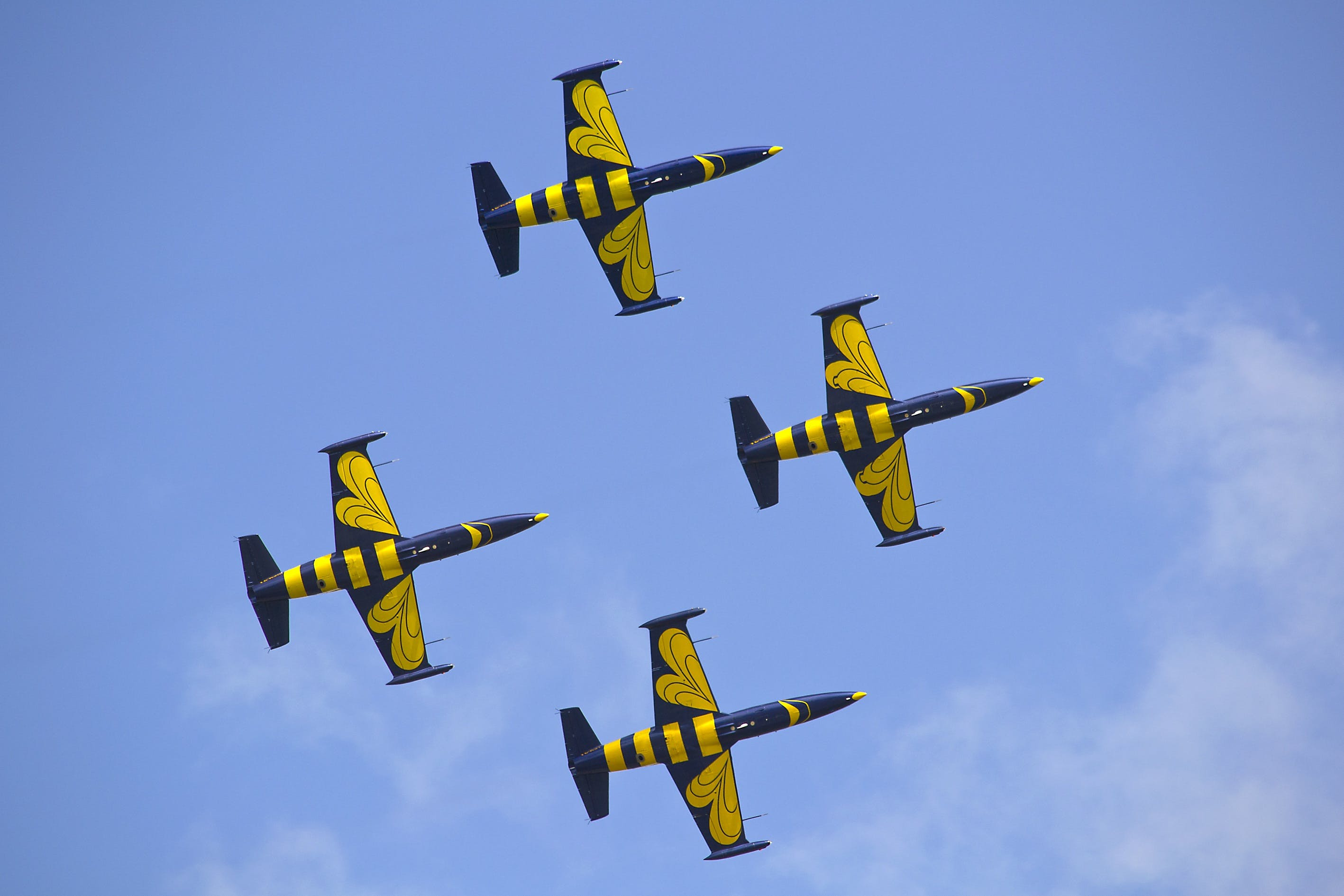 Yellow and Black Air Craft during Blue Sky