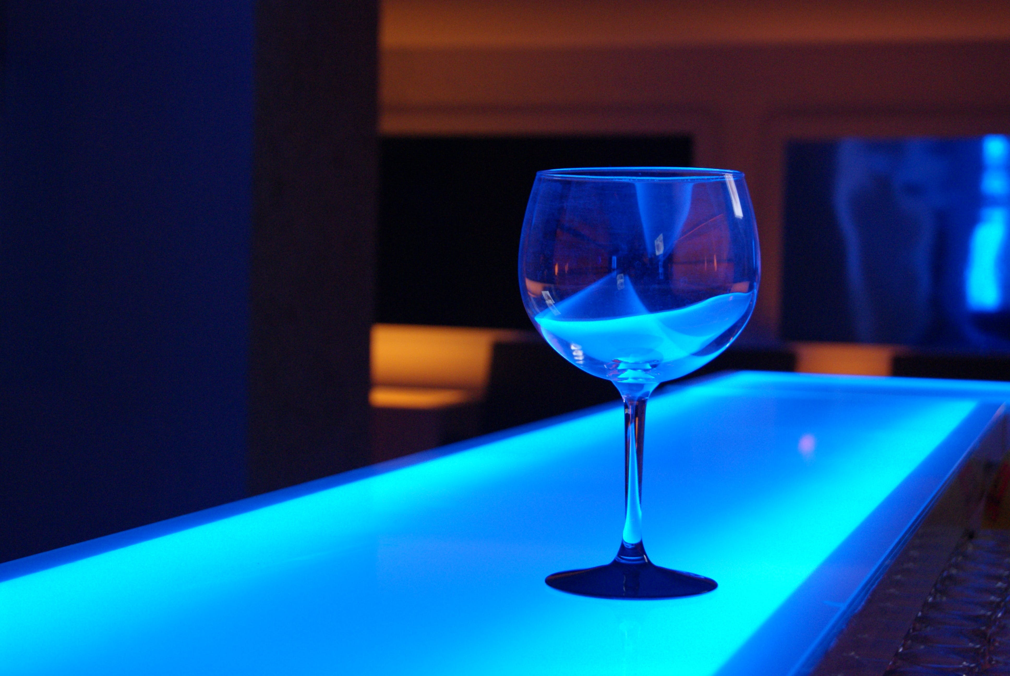 Clear Long Stem Wine Glass on Bar Table