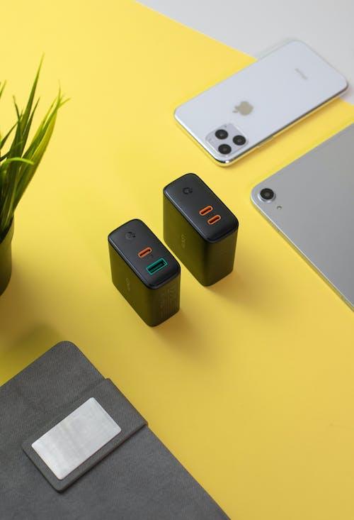 Modern power supply blocks on table near gadgets