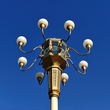 Brown Metal Street Lamp Under Clear Blue Sky during Daytime