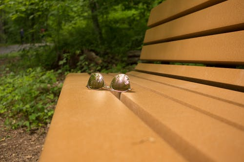 Free stock photo of bench, light reflection, lost, park bench