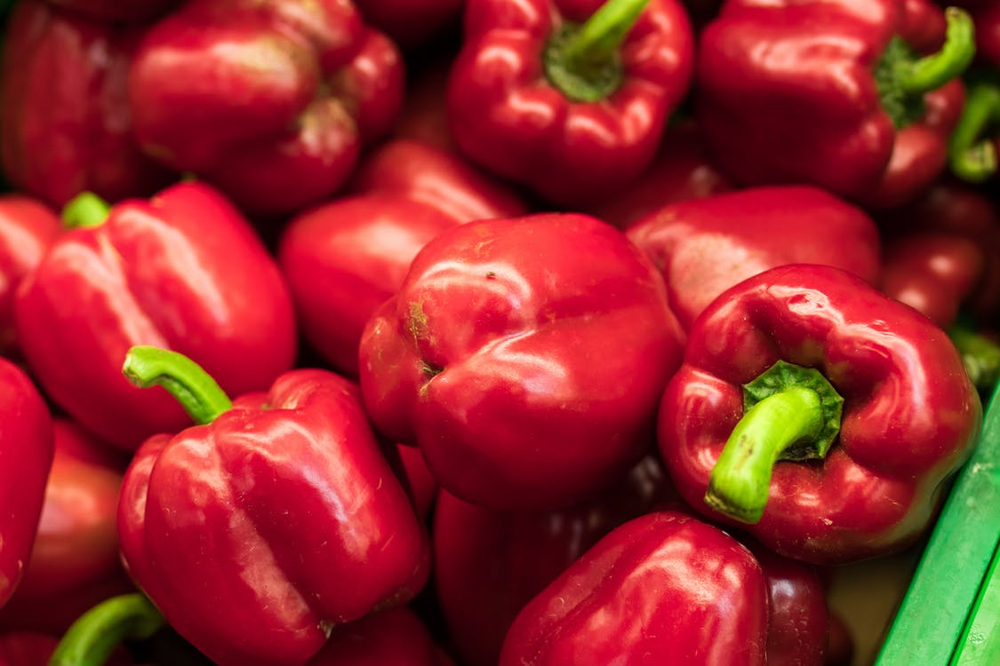 Selective Focus Photography of Red Bell Pepper