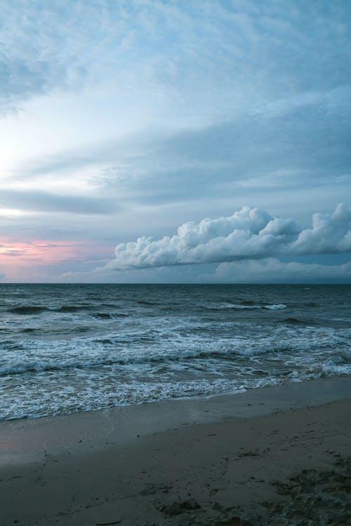 Seascape in cloudy weather in sundown