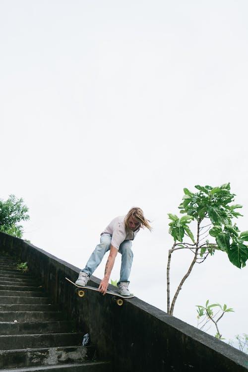 Skater board sliding down on stair ledge