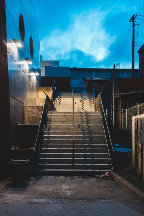 Stairway of contemporary building on street in evening