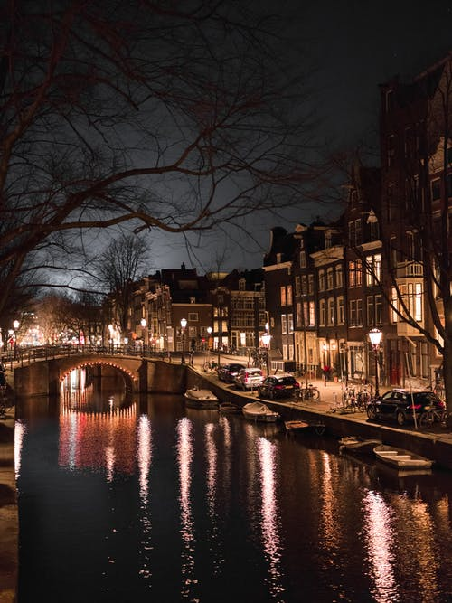 Old town street and canal at night