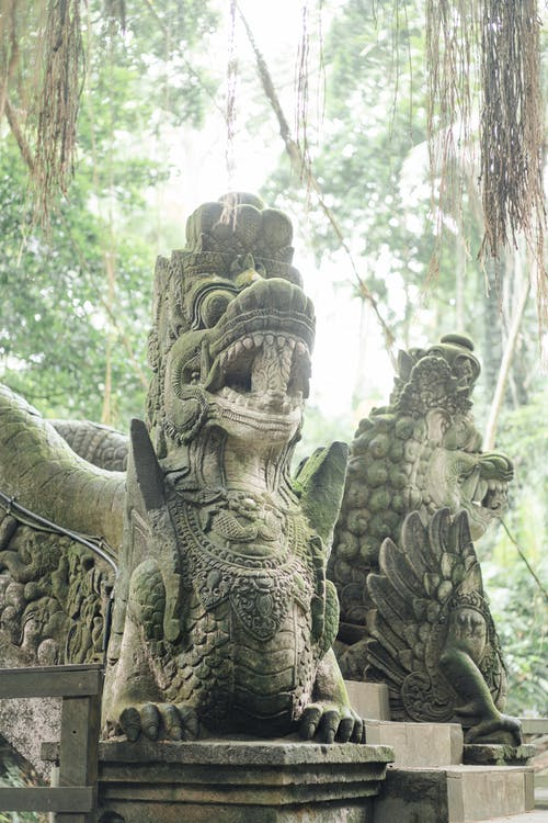 Statue of Asian mythological creatures in rainforest