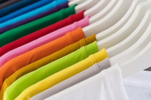 Rack with trendy vibrant multicolored t shirts