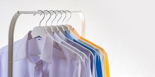 Hangers with formal shirts on rack