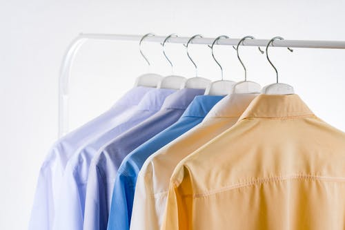 Hangers with classic shirts collection on rack