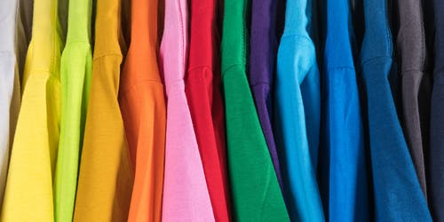 Collection of multicolored t shirts in shop