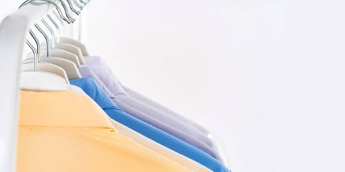 Different formal shirts on hangers for sale
