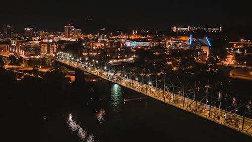 Modern long bridge over river at night