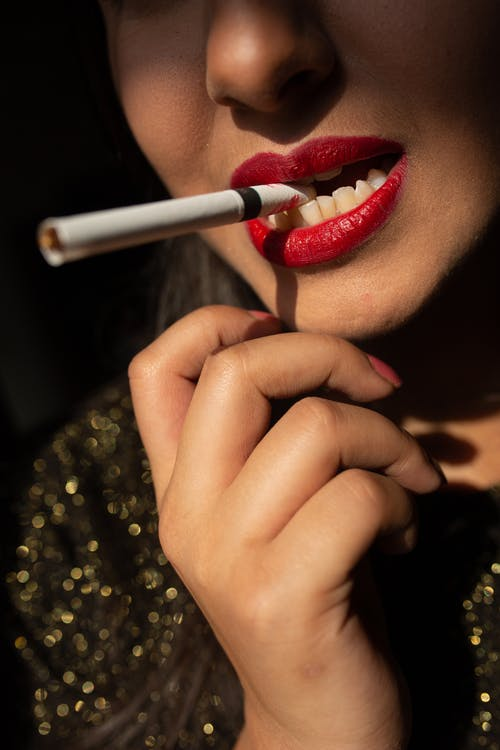 Woman With Red Lipstick Holding Cigarette Stick