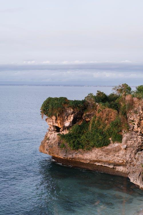 Verdant Balangan Cliff in Bali overlooking blue ocean
