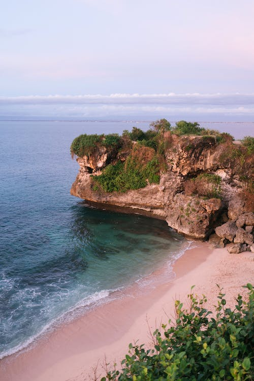 Picturesque Balangan Beach with verdant cliff in Bali