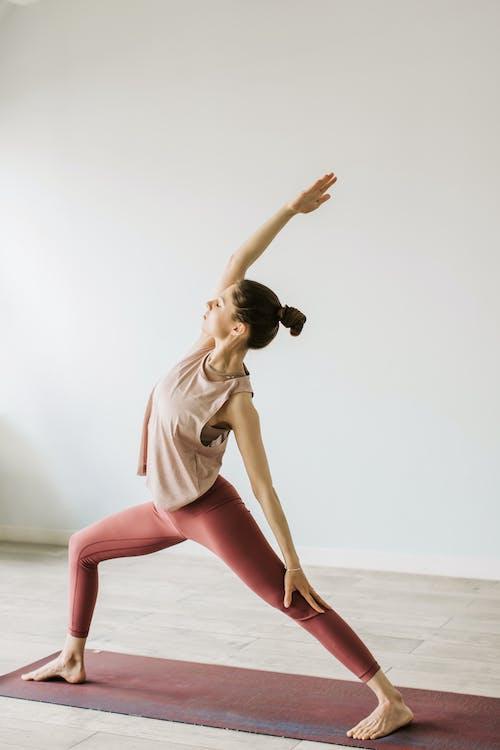 Woman in Tank Top and Leggins Doing Yoga