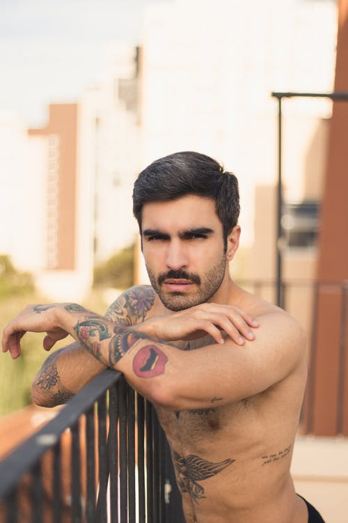 Topless Man With Tattoo on His Body