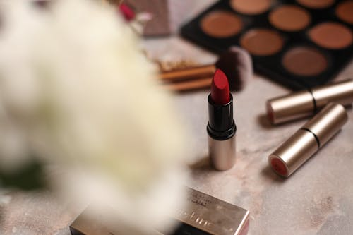 Set of bright cosmetic products on table at home