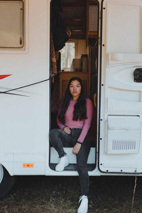Woman Sitting on Campervan Stairs