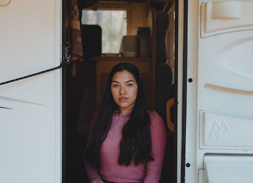 Woman in Front of her Campervan Door