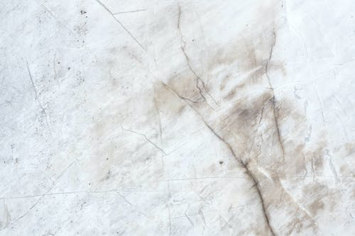 White marble surface with chaotic lines