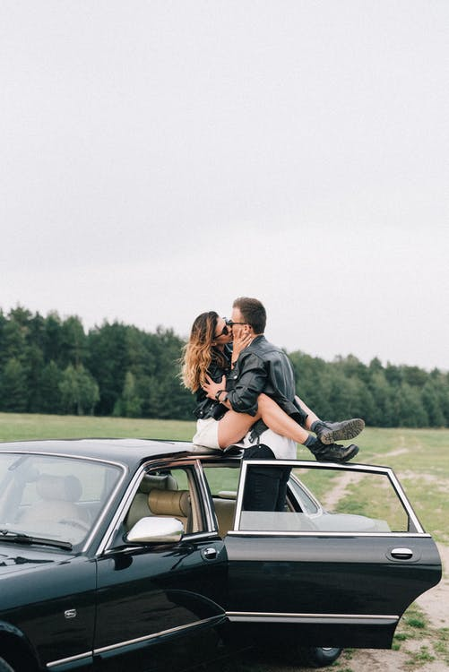 Man and Woman Kissing on the Car