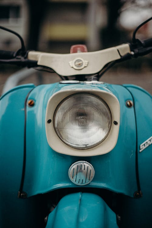 Blue and Silver Motorcycle With Headlight