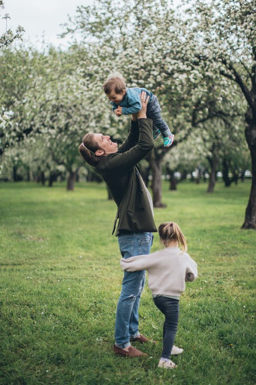 Father With his Children at a Park