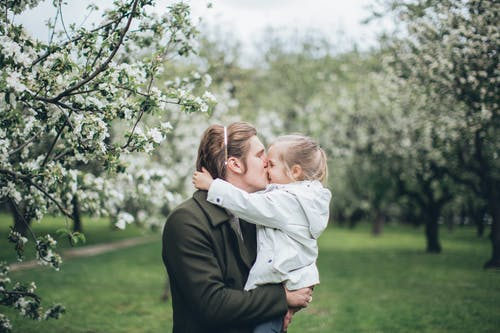 Father Carrying a Daughter and Giving a Kiss
