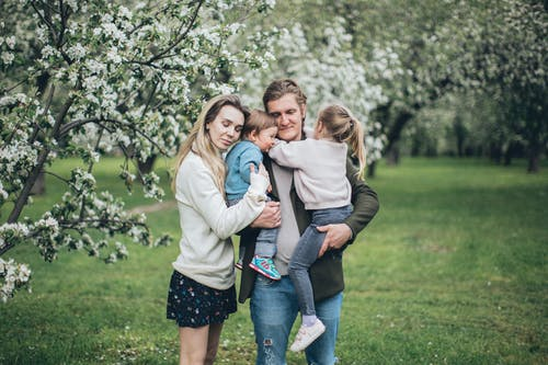 Happy Family Hugging Outdoors