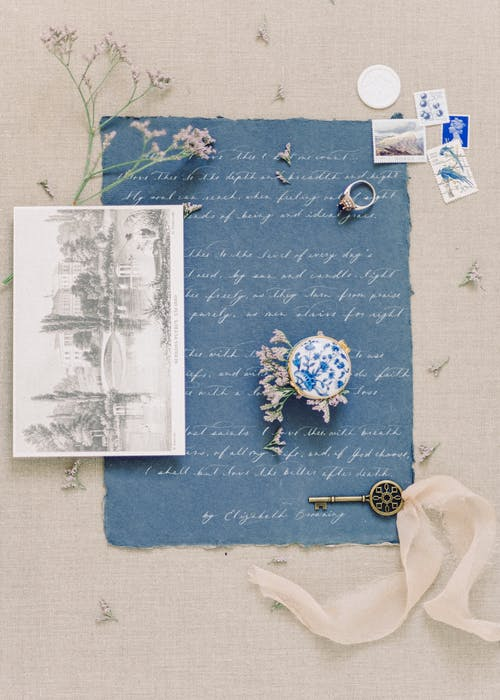 White Printer Paper on Blue and Green Floral Textile